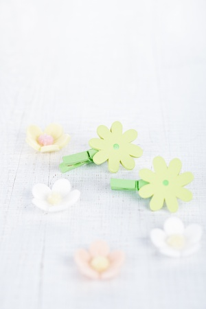 decorative flower pegs with sugar flowers on white old table Stock Photo - 16810356