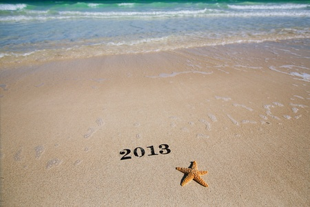 2013 new year metal numbers on beach sea sand, shallow DOF photo