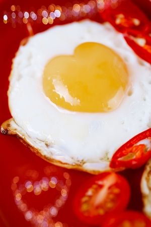 fried egg with heart shape yolks and heart shaped bokeh, lovely breakfast photo