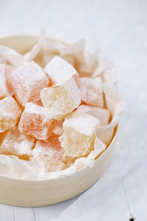caster: turkish sweet delight, rose and yellow, dusted with caster sugar