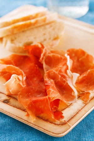 Platter of serrano jamon Cured Meat and ciabatta photo
