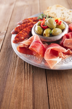 cured: Platter of serrano jamon Cured Meat, Ciabatta, chorizo and olives