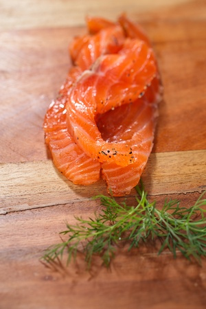 smocked salmon homemade, with spice on wooden board Stock Photo - 20555876