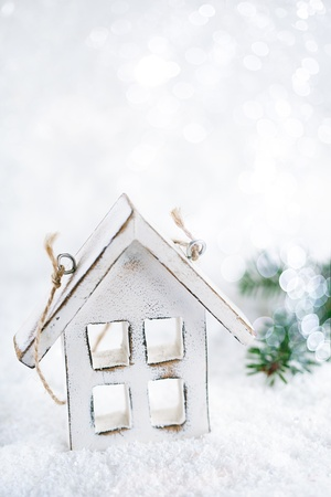 wooden house christmas decoration on white snow background photo