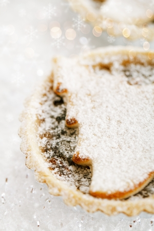 minced pie: christmas  tart with marzipan tree on white snow festive background