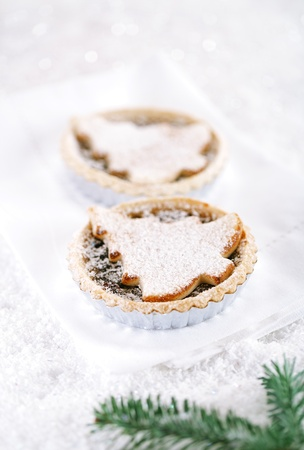 christmas  tart with marzipan tree on white snow festive background photo