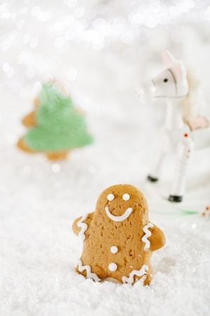 Gingerbread man and tree on a festive Christmas snow background, nice postcard photo