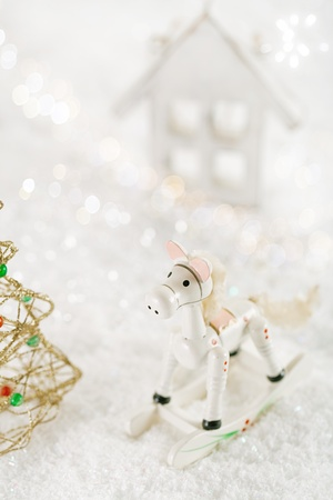horse christmas decoration on white snow background photo