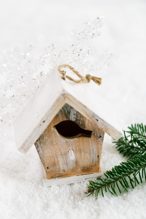 stock photo wooden bird house christmas decoration on white snow background - Bird House Christmas Decoration