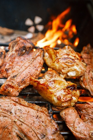 bbq chicken: food meat - chicken and beef on party summer barbecue grill. Shallow dof. Stock Photo