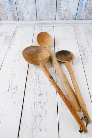 retro kitchen utensils  wood spoon on old wooden table in rustic style Stock Photo - 22556870