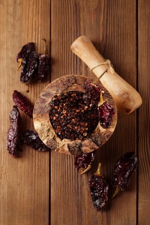 dried food: chipotle - jalapeno smoked chili in wooden mortar