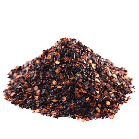pepper flakes: chipotle - jalapeno smoked chili pile isolated on white