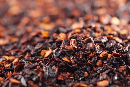 pepper flakes: chipotle - jalapeno smoked chili flakes background, shallow dof