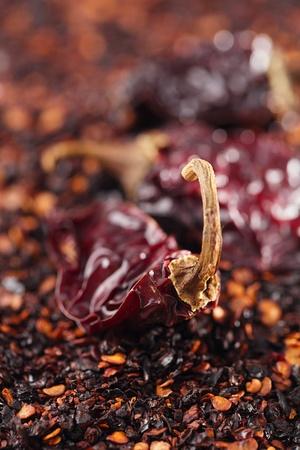 pepper flakes: chipotle - jalapeno smoked chili flakes and whole background, shallow dof