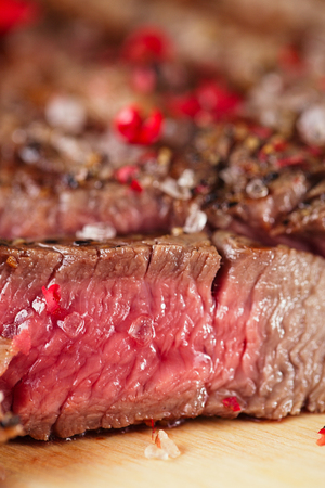 steak beef: Beef steak on a wooden board and table