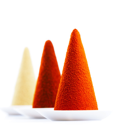 ground spices on white background chilli, paprika, tumeric and ginger cone piles, bright colors. photo
