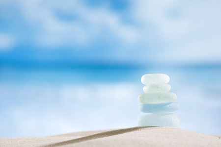 standing stones: sea glass seaglass with ocean , beach and seascape, shallow dof Stock Photo