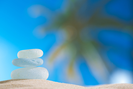 sea glass seaglass with ocean , beach and palmtree seascape, shallow dof photo