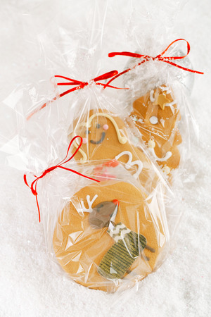 Gingerbread  cookie in clear bag on a festive Christmas snow  photo
