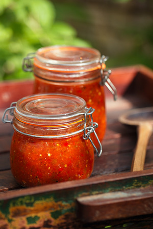 chilli sauce: Jar of home made classic spicy Tomato, Chillie, garlic and Peper sauce salsa