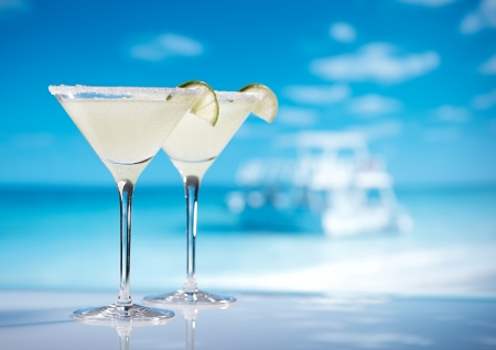 margarita  cocktail on beach, blue sea and sky
