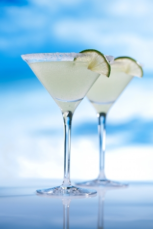 margaritas: margarita  cocktail on beach, blue sea and sky