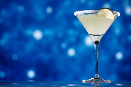 margarita  cocktail on star glitter isolated on dark blue photo