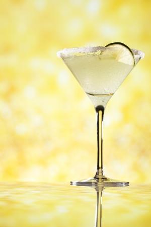 margaritas: margarita  cocktail glitter golden background, shallow dof
