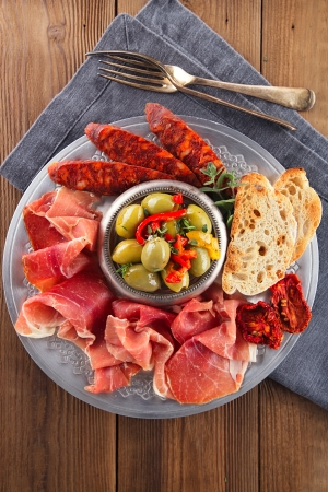 Platter of serrano jamon Cured Meat, Ciabatta, chorizo and olives