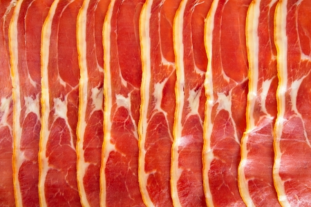 cured ham: Platter of serrano ham jamon Cured Meat background texture full frame Stock Photo