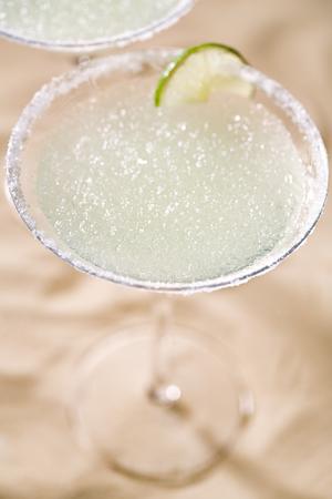 slush: margarita  cocktail on beach sand background Stock Photo