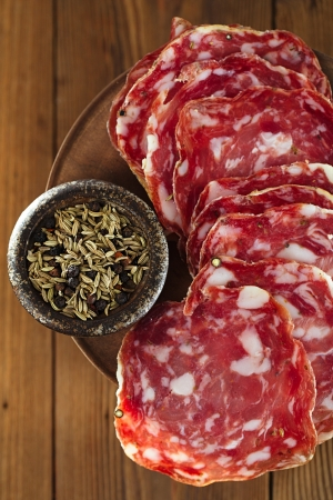 french salami with black peppercorn and fennel spices Standard-Bild
