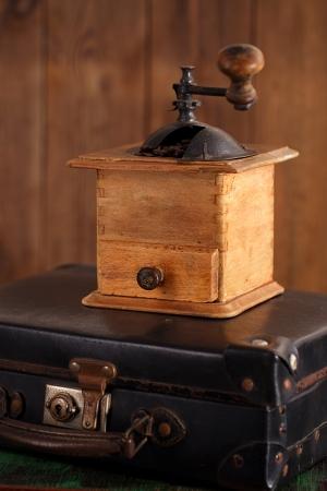 Nostalgic coffee grinder on retro suitcase photo