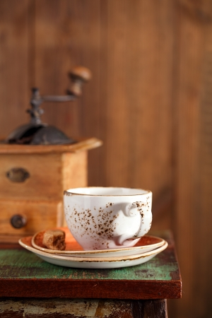 coffee cup with Nostalgic coffee grinder on background photo