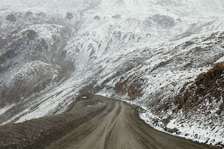 steep turn high mountain road from Barskoon valley in Kyrgyzstan,  Tyan Shan mountains photo