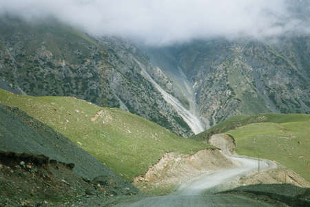 kirgizia: steep turn high mountain road from Barskoon valley in Kyrgyzstan,  Tyan Shan mountains