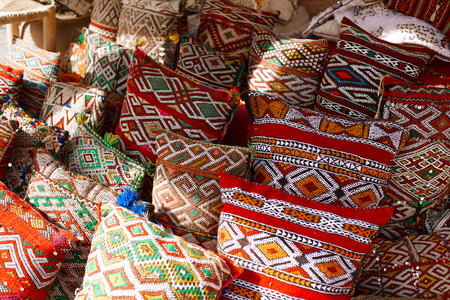 souk: Moroccan cushions in a street shop in medina souk