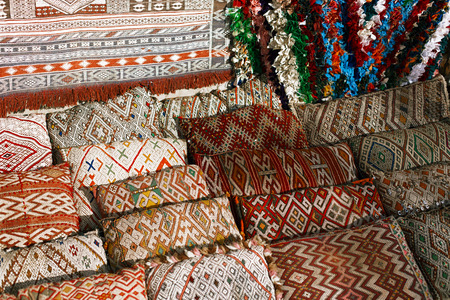 Moroccan cushions in a street shop in medina souk photo