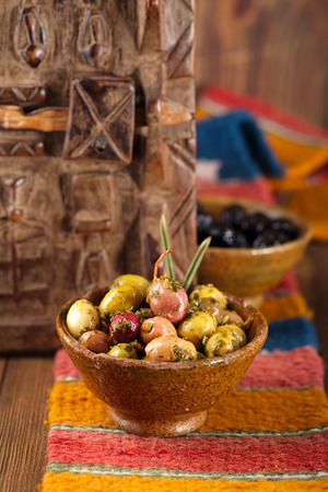 marinated Olives in bowls with moroccan  ornament on wood, shallow dof photo