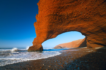 Legzira dramatic natural stone arches reaching over the sea, Atlantic Ocean, Morocco, Africa Stockfoto