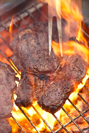 rib eye: food meat -  rib eye beef steak on party summer barbecue grill with flame. Shallow dof. Stock Photo