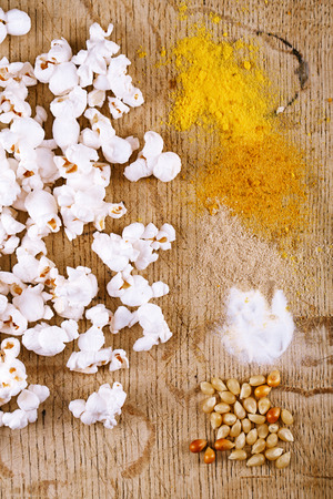 kernels: healthy popcorn with defferent type of salt and kernels  on wooden board