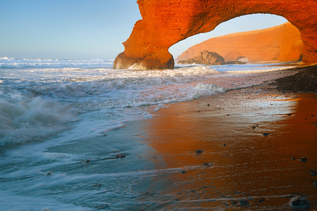 stone arches: Legzira dramatic natural stone arches reaching over the sea, Atlantic Ocean, Morocco, Africa Stock Photo
