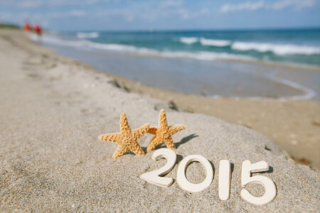 2015 letters with starfish, ocean , beach and seascape, shallow dof