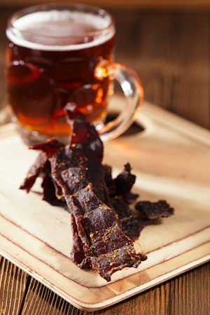 cured: jerky beef with beer - homemade dried cured spiced meat Stock Photo