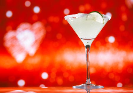 margaritas: margarita  cocktail glitter red golden background, shallow dof