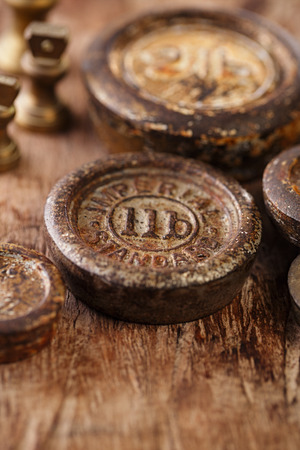 Vintage brass kitchen  weights on old wooden table photo