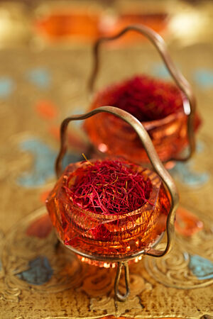 saffron spice in antique vintage glass bowl, closeup photo