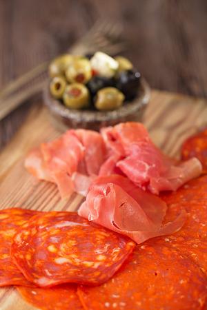 Platter of serrano jamon Cured Meat, , chorizo and olives photo